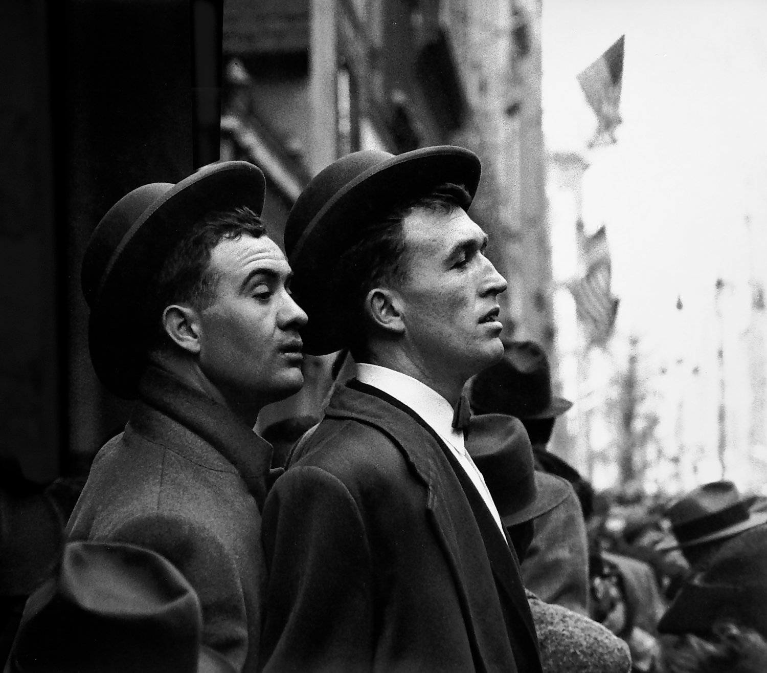 - Two young Irishmen watch the Saint Patrick's Day parade in New York City. - Photojournalism - Life Magazine - Black and white photography - Canon rangefinder and SLR cameras - - art  - photography - by Tony Karp