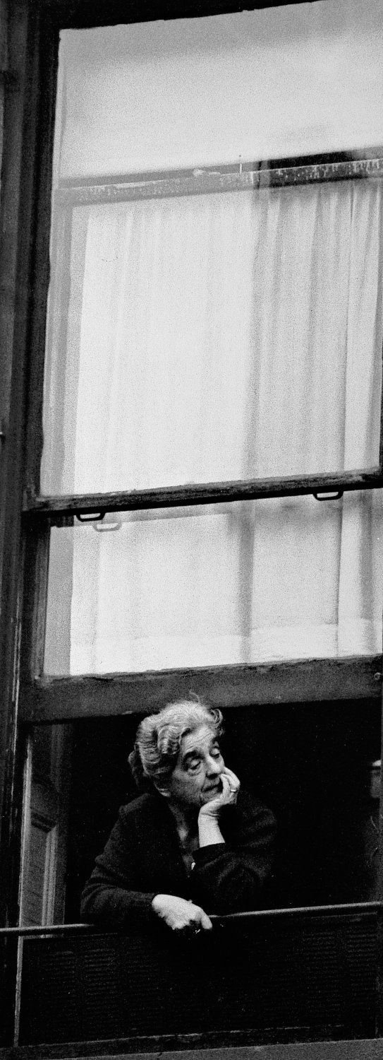 - Another old lady watches the afternoon go by. - Photojournalism - Life Magazine - Black and white photography - Canon rangefinder and SLR cameras - - art  - photography - by Tony Karp